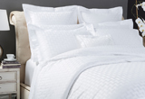 Bed linen, bath and deck towels by Frette